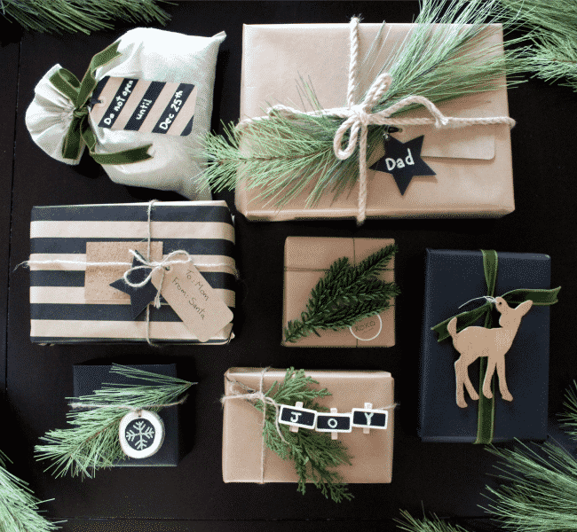 I love the black, white and green. The greenery and wood and perfect natural elements for your gift wrapping!