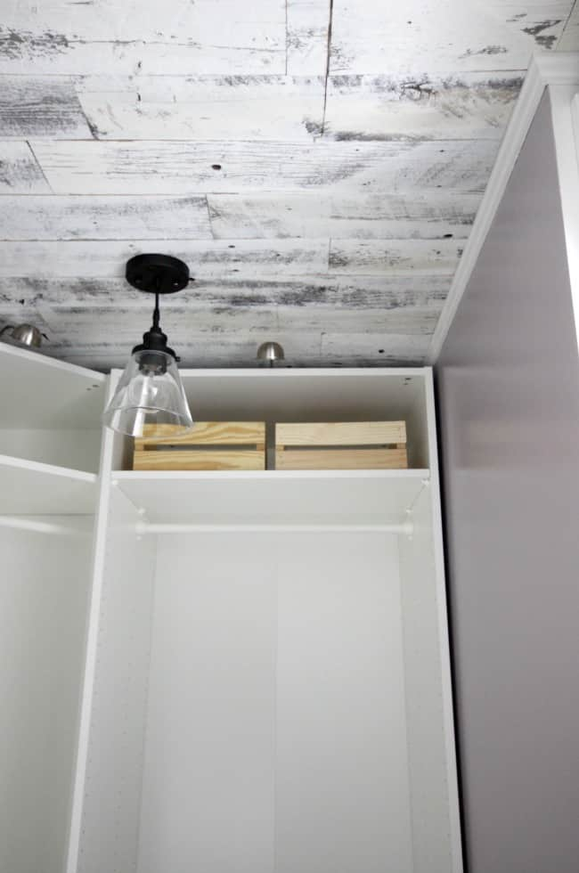 A weathered wood ceiling is a simple way to make a huge statement in this closet.