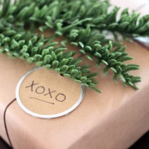 The perfect rustic gift wrapping ideas. I love the black, white and green. The greenery and wood and perfect natural elements!