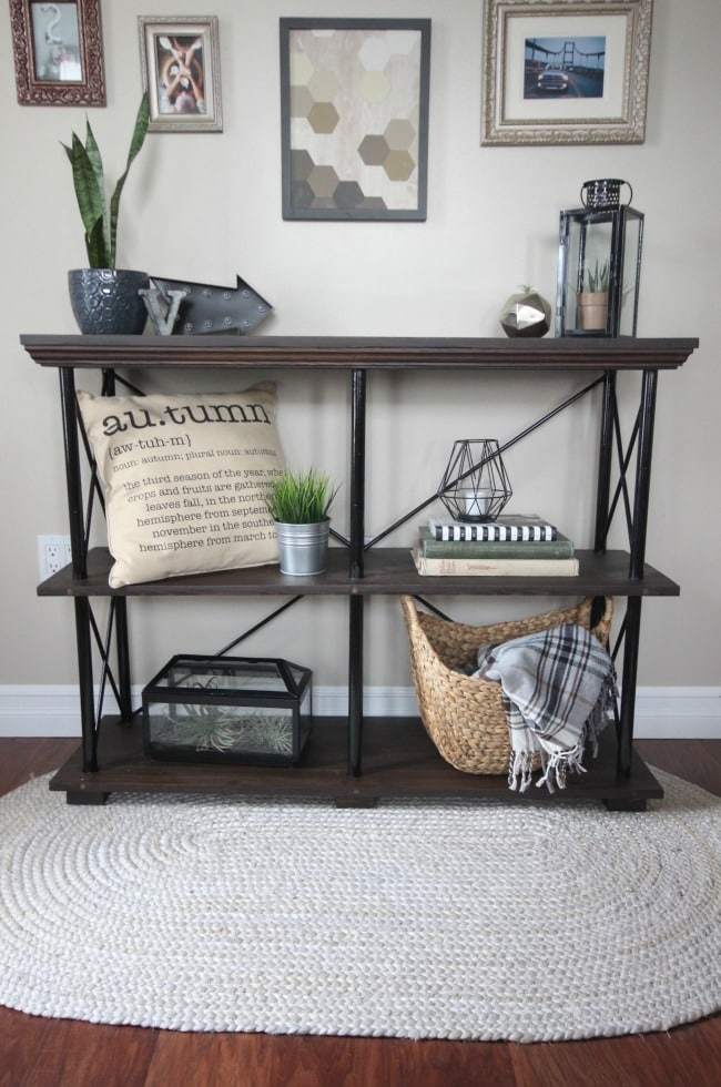 Free build plans for this beautiful rustic industrial furniture piece. This DIY shelf would look perfect in any living room, family room, or in the kitchen as a side board! Love the idea!