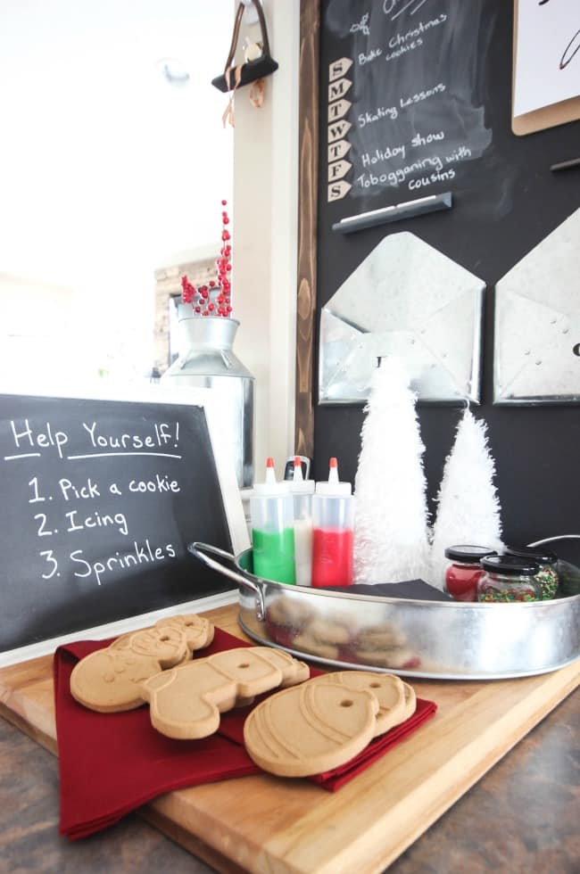It only takes a few minutes to set up the perfect cookie decorating station! Kids, babysitters, family and friends will ALL love visiting your place this Christmas :)