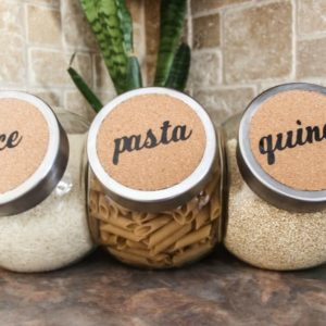 Quick and easy cork labels to organize your kitchen or bathroom! Turn dollar store buys into stylish decor with the Cricut Machine!