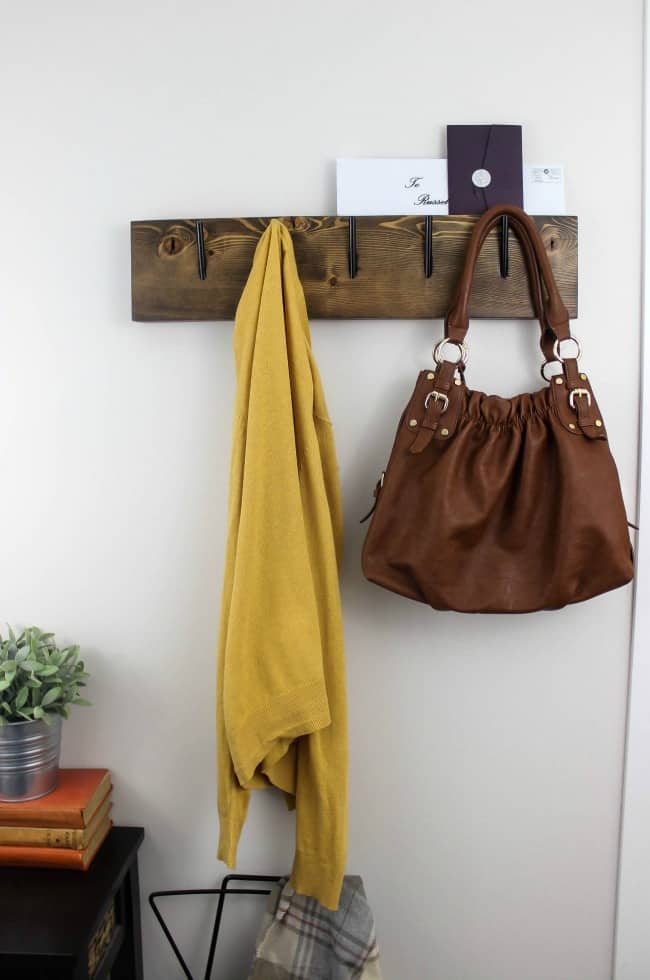 Make your own modern industrial coat rack with these free build plans! The perfect diy idea to organiza any entryway! Love the mail slot on top :)