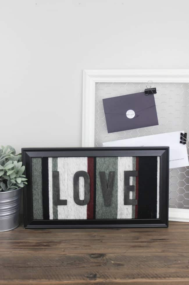 LOVE how she repurposed this old picture frame to make some creative wall art! Great idea for using up your yarn!