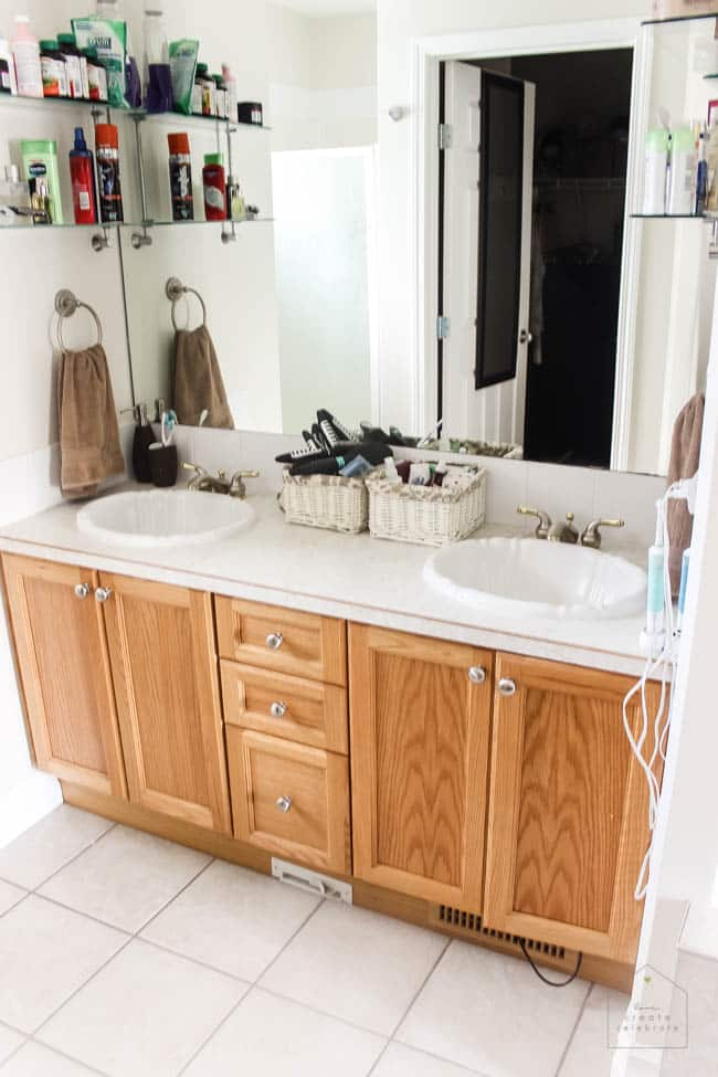 Love this modern bathroom design! Gorgeous faucets, fixtures, and tile choices! Follow along as this outdated bathroom is transformed into a beautiful modern oasis!