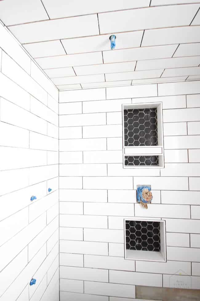 Update on our modern bathroom renovation! LOVE these beautiful shower tiles!