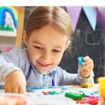 "Child making crafts with text reading ""best glues for kids"""