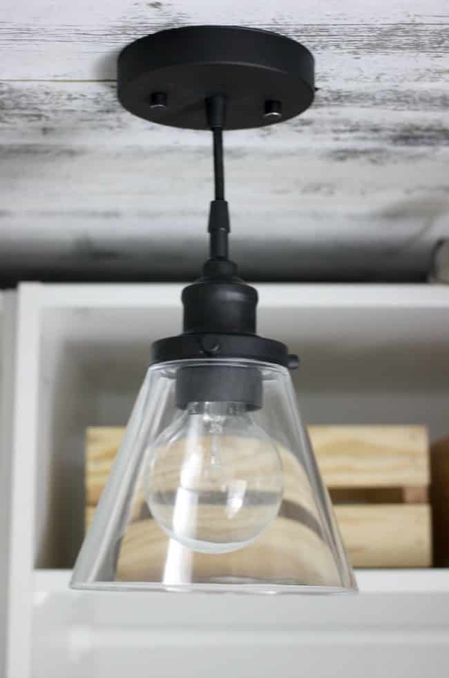 Update a cheap light fixture to get a chic and inexpensive look! Love the transformation of this fixture!