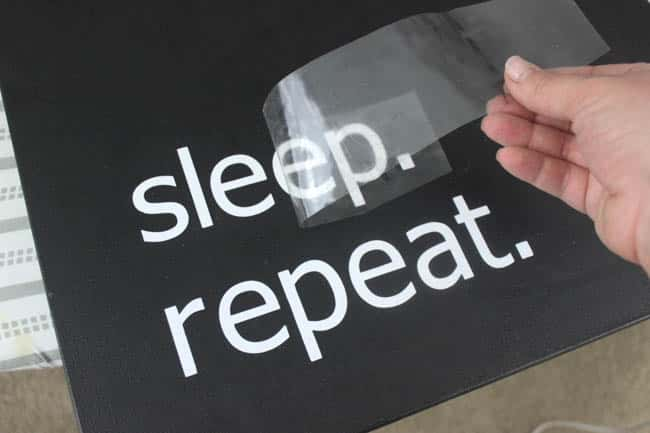"Make your own custom typography canvas with iron-on vinyl and paint. A sleek modern canvas for your bedroom or bathroom. Love the ""wake up. kick ass. sleep. repeat."""