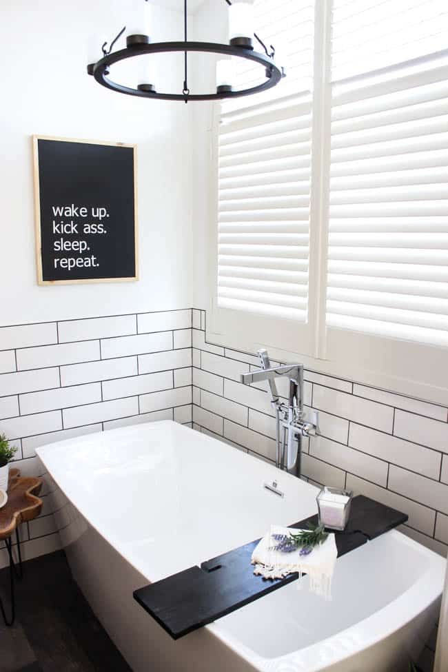"Make your own custom typography canvas with iron-on vinyl and paint. A sleek modern canvas for your bedroom or bathroom. Love the ""wake up. kick ass. sleep. repeat."" Canvas art in a modern bathroom"