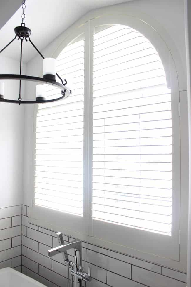 These shutters let tons of natural light in the newly remodeled bathroom.