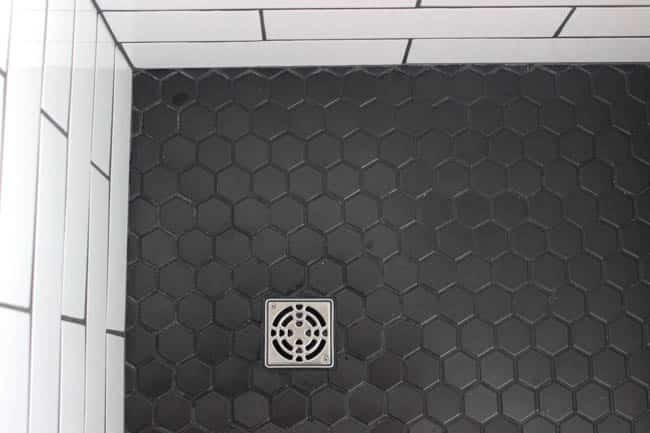 The geometric shower floor adds dimension.