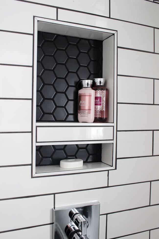 This small detail matches the geometric shower floor.