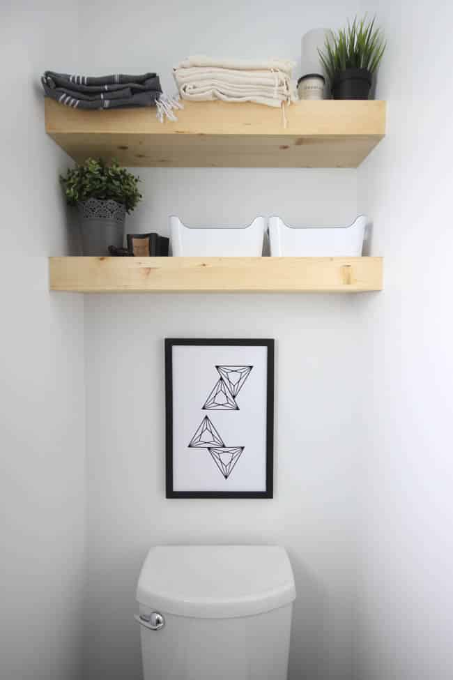 Floating, wooden shelves add storage and placement for decorations.