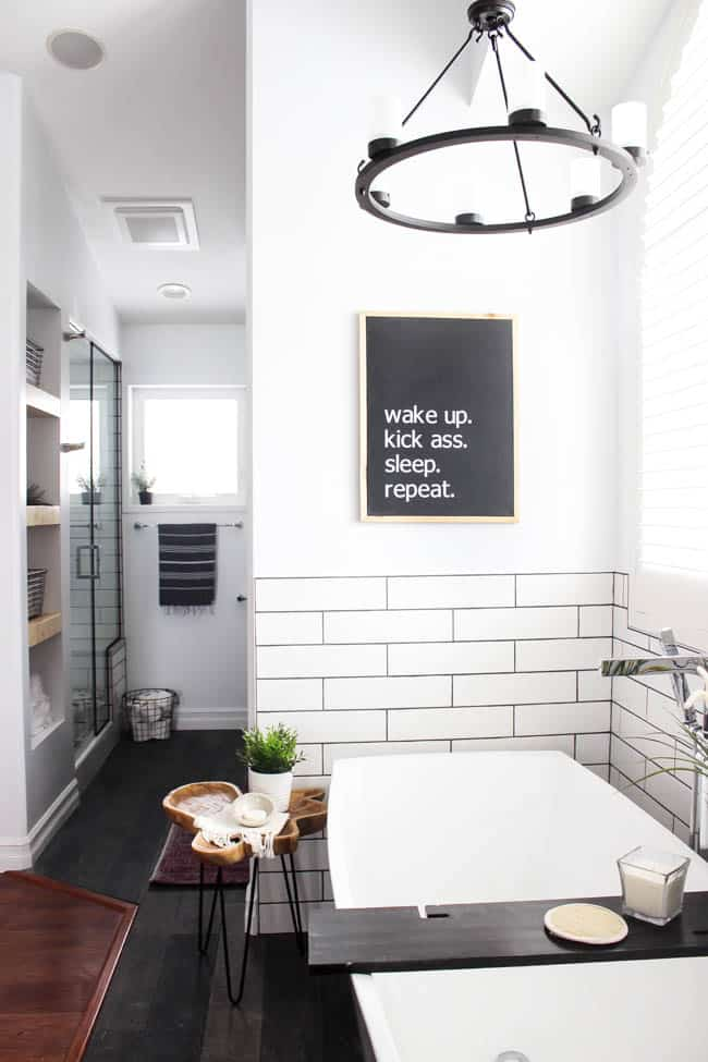 "Make your own custom typography canvas with iron-on vinyl and paint. A sleek modern canvas for your bedroom or bathroom. Love the ""wake up. kick ass. sleep. repeat."" Art in a beautiful modern bathroom."
