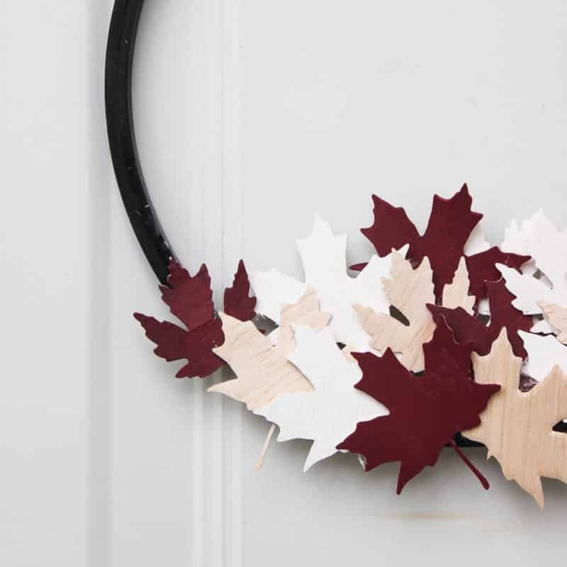 A beautiful modern hoop wreath for Canada Day! Using a simple embroidery hoop and balsa wood maple leaves, you can celebrate the birthday of Canada in style! Love the red, white, and black!