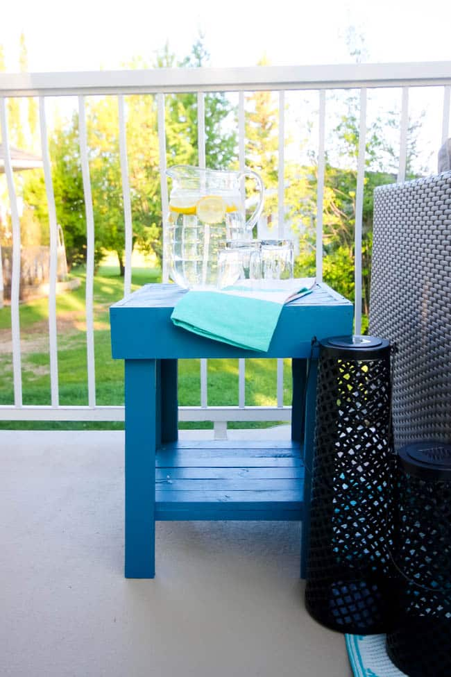 A stunning backyard makeover inspired completed with Behr paints. Love the bright painted blue doors, and the grey outdoor sectional. Beautiful DIY pallet side tables, and black and white accessories complete the space. Summer is here!