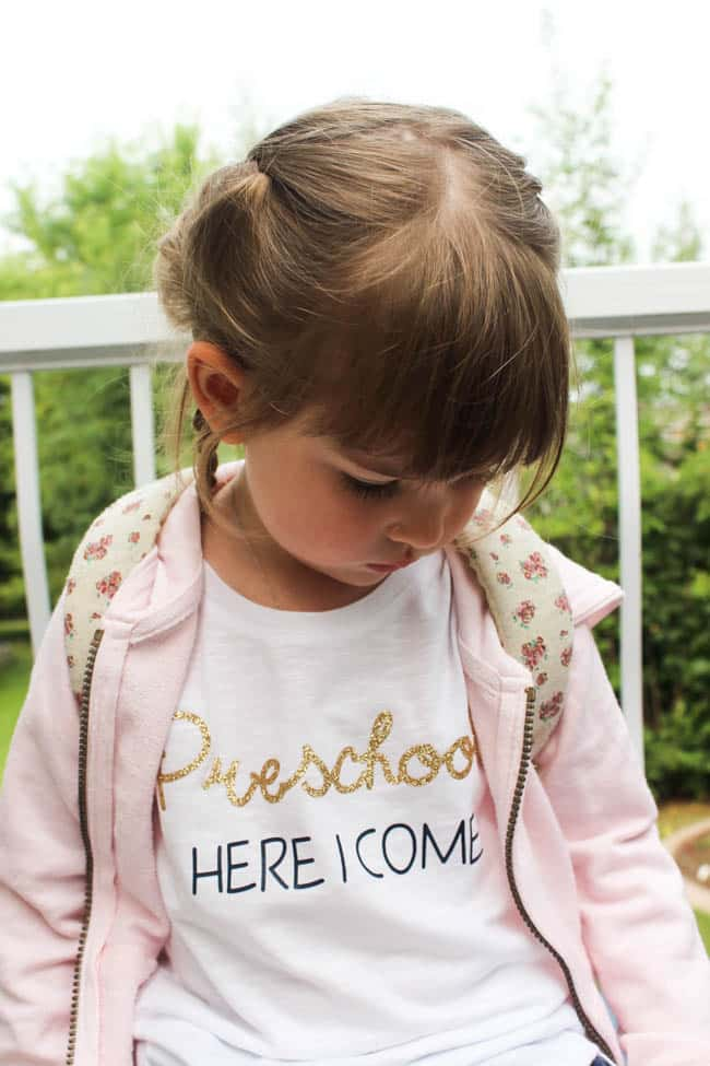 "Little girl wearing ""Preschool here I come"" t-shirt."