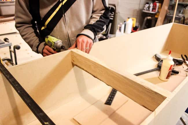 Glue and screw the 2x4s into place inside the MDF box