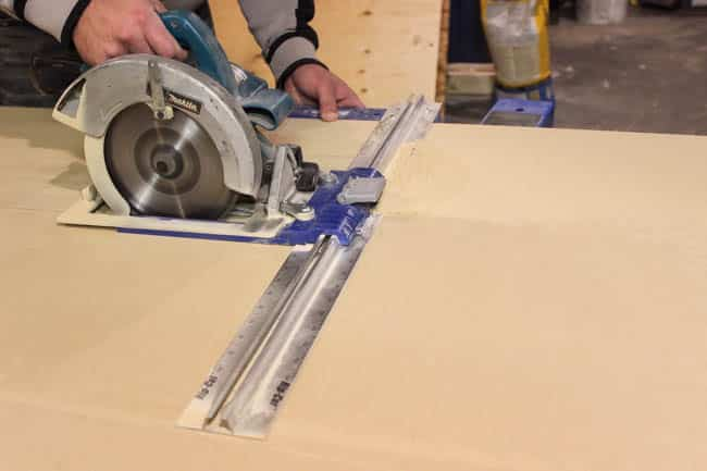 Using a rip-cut to cut the MDF for the shelving