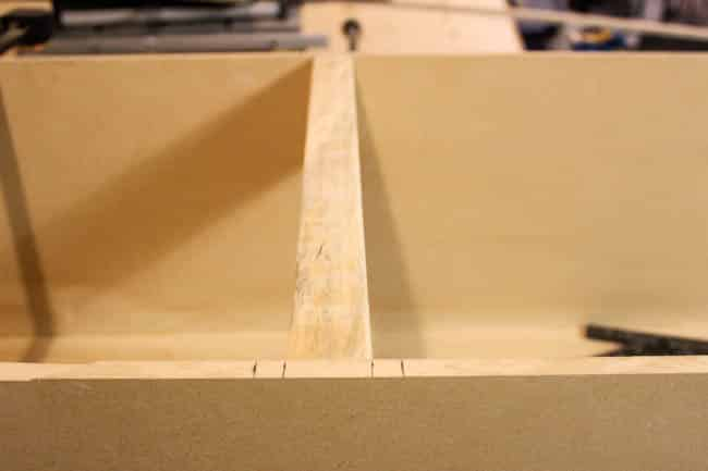 Divide the MDF box into equal parts for your shelving