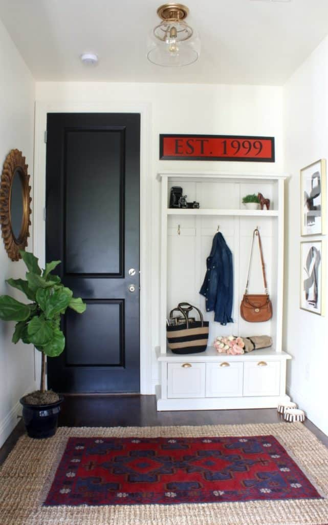 Beautifully layered modern modern rugs for any room in the home! LOVE this beautiful design trend and now you can incorporate it into your home with beautifully layered sisal, jute, cowhide, and modern rugs. Love this mudroom!