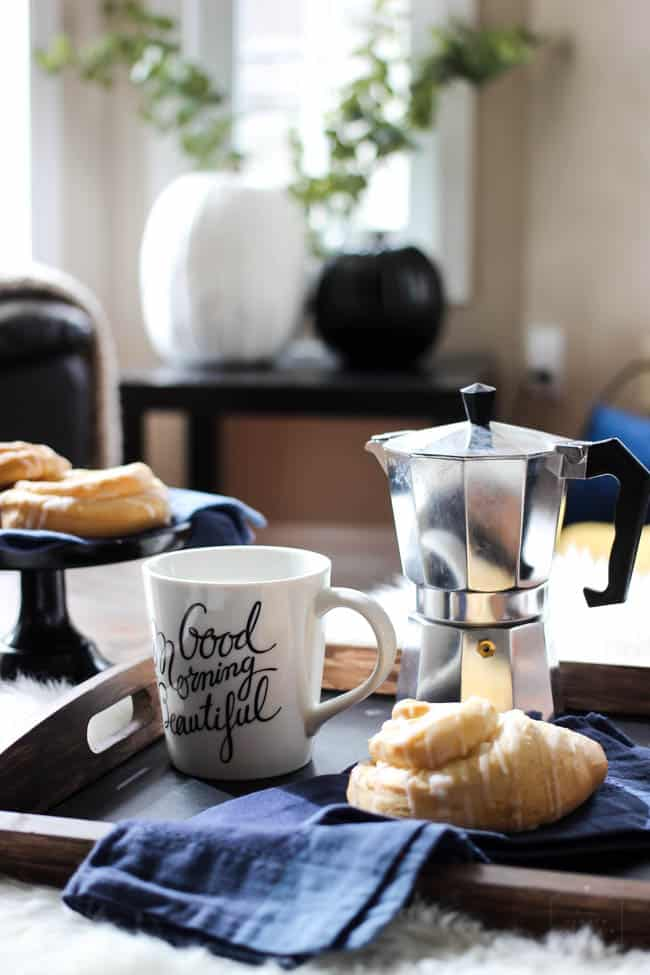 Pastries and coffee on the coffee table