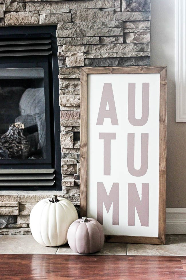 Love these Fall and Christmas custom wood signs! Beautiful decor for the fall and holiday seasons. Learn how you can make your own custom wood sign for the home with this simple DIY tutorial. The perfect sign and shape for your fireplace and mantle decor!