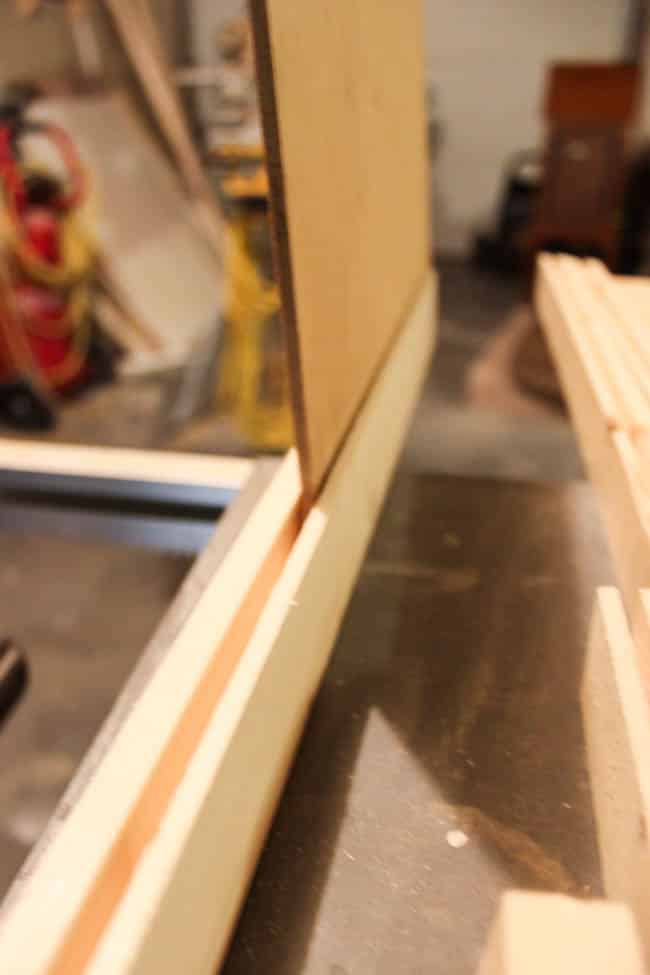 The plywood should fit snugly into your frame