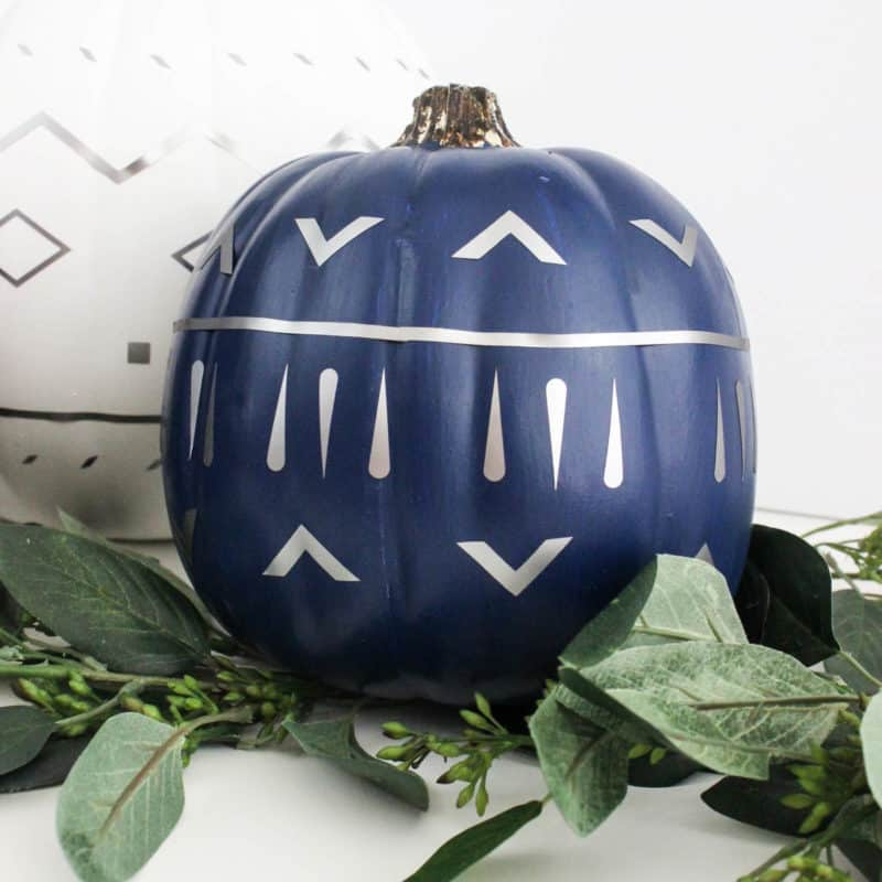 Make your own modern fall decor! Use your Cricut Machine and adhesive foil to create these beautiful patterned pumpkins! LOVE the navy, black and white pumpkins for a non-traditional fall!