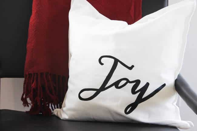 This joy pillow is quick and easy and brightens the space for the holidays