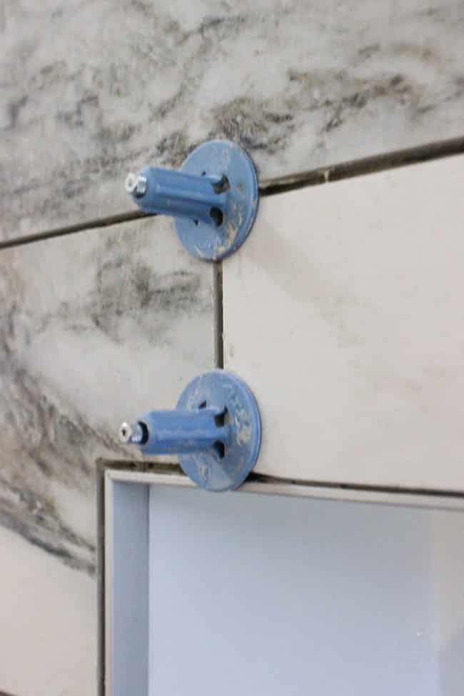 These spindles help keep tile level while they dry