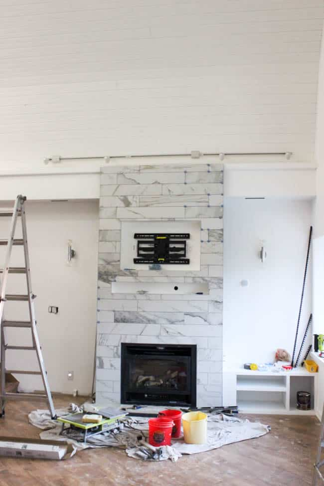 A One Room Challenge Update showing off our newly tiled fireplace and furniture arrivals! Plus an ATR Tile Leveling System Review.
