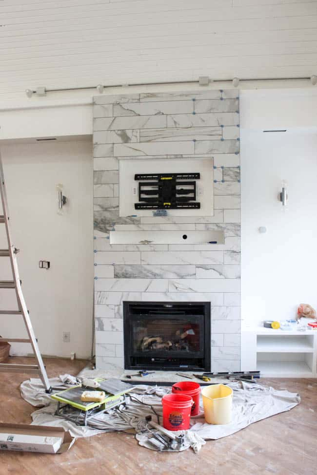 the ATR Tile Leveling Alignment System helped move along our one room challenge by making the fireplace tiles look amazing