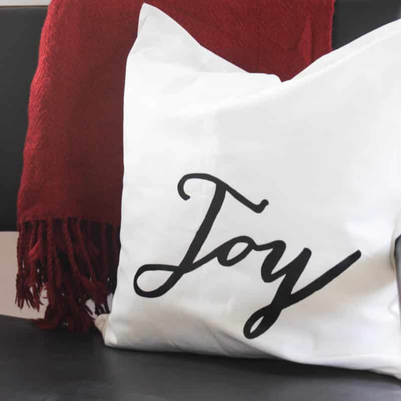 "The easiest ever Christmas Pillows to make! These festive DIY holiday pillows will have everyone wondering where you bought them! Make them in less than 30 minutes and enjoy these modern pillows for the entire season. Download the ""joy"" and deer images free!"