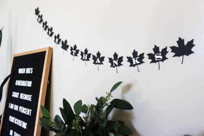 A beautiful modern fall decor idea. Make this simple black and white DIY leaf banner to celebrate Thanksgiving Day!