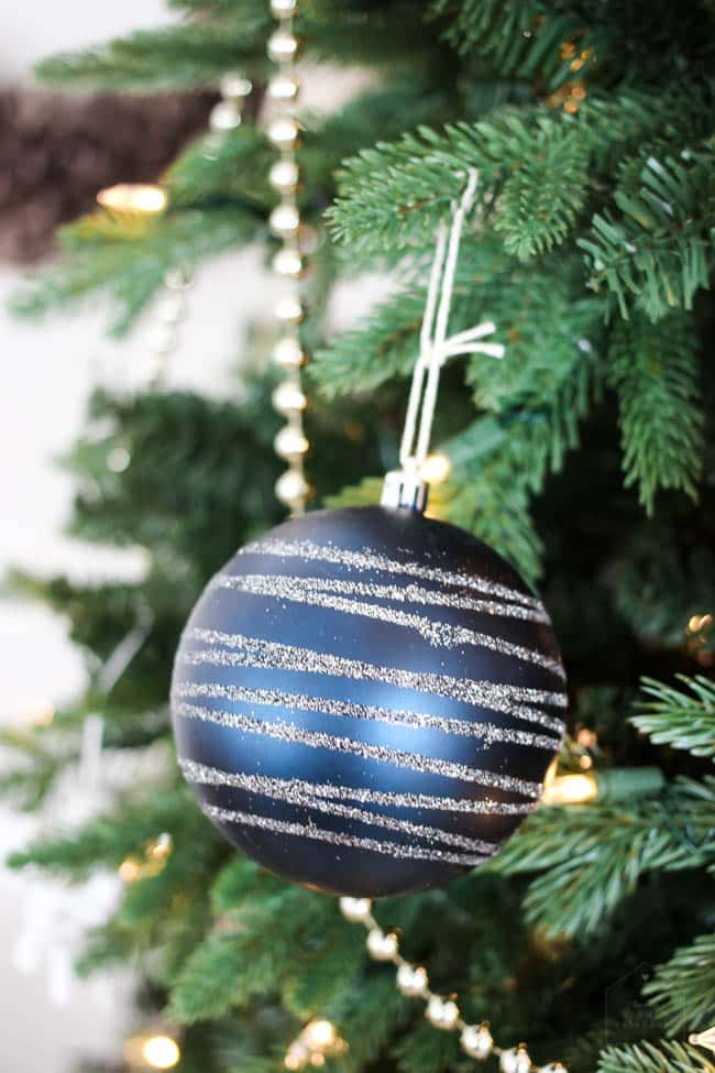 Simple ornaments like this blue and silver glitter globe add a sparkle to your Christmas tree