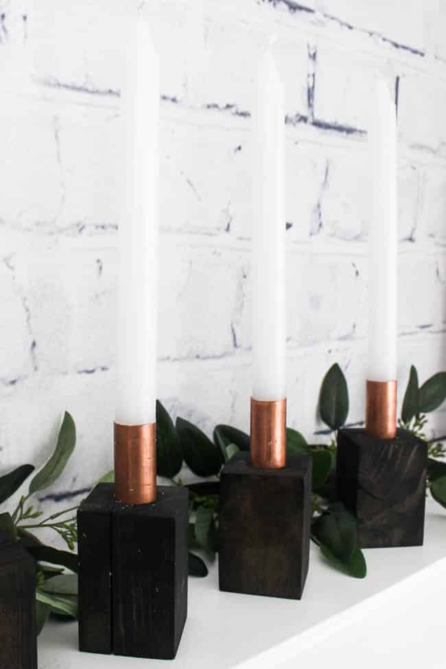 I love these beautiful modern Advent Candlesticks. This DIY is the perfect addition to your Christmas decor and the perfect way to celebrate the meaning behind Christmas. The addition to celebrate advent this holiday season!