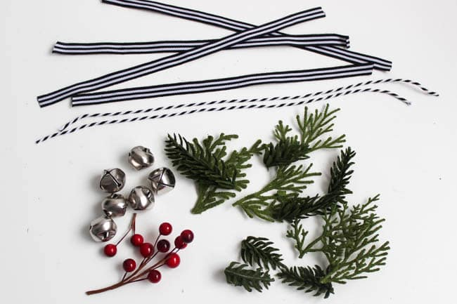 An easy DIY ornament idea for Christmas. These festive holiday wreaths are perfect for your tree, or as gifts for friends and family. Love that these would look perfect with any decor style: modern, rustic, farmhouse, you name it!
