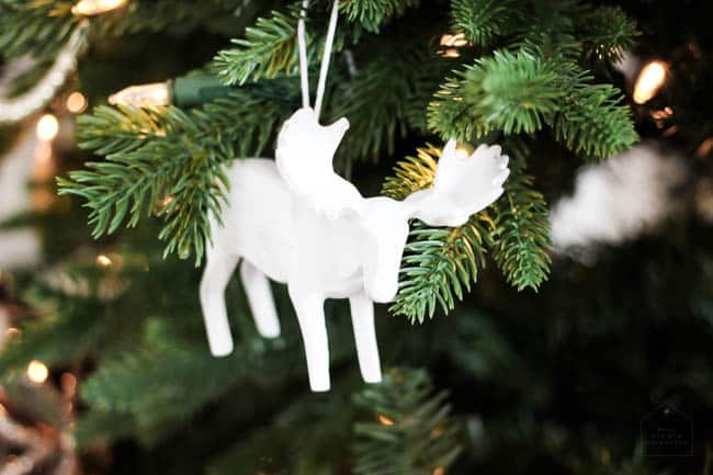 Little details like this moose ornament add to the theme of this Christmas tree