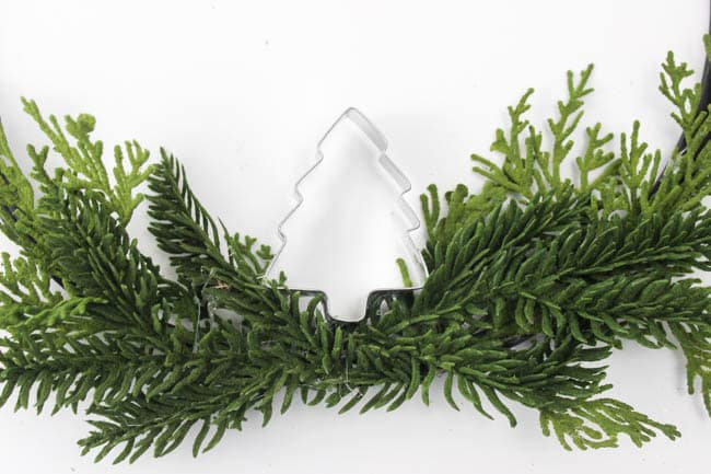 Simple, affordable, and adorable! Follow these easy steps to make your own five minute Christmas wreath.