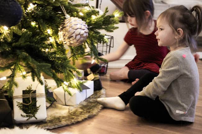 Girls sitting with the Christmas Tree!