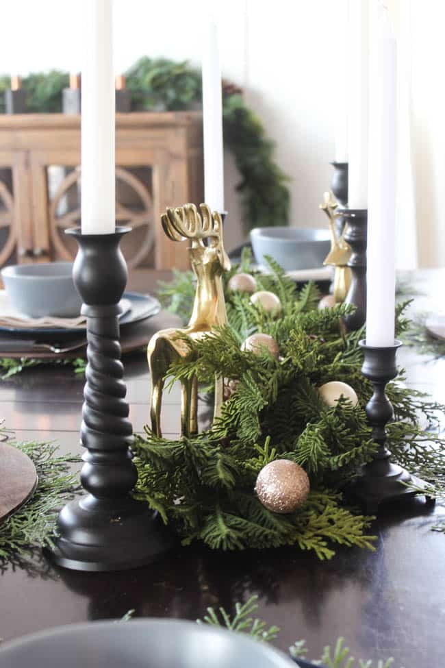 Centrepiece with greenery stems and gold and black accents