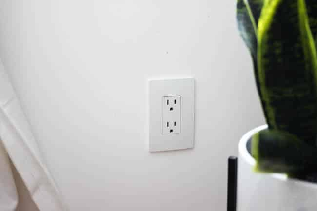 Screwless wall plates like this electrical outlet have a sleek and modern look