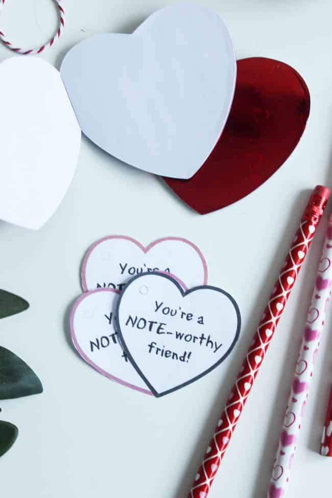 Simple Notebook Valentines using Dollar Store notebooks and pencils! Download the FREE printable Valentines now for your kids to take to school!