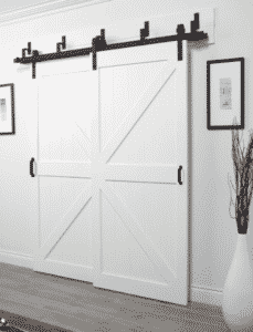 Modern Hallway Barn Door - Beautiful modern hallway design plans! Love how the hallway lighting, the long runner, and the barn doors mix together for the perfect modern design.