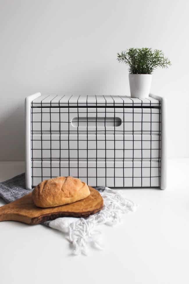 Wow! This transformation is stunning! DIY your own old or thrifted wooden bread box with just a few supplies! Love the modern look of this new bread box makeover! The perfect addition to your kitchen.