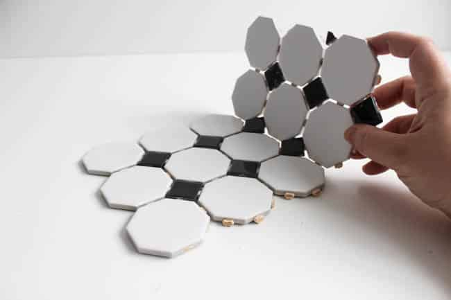 Beautiful Modern Trivets! Make your own with a bit of leftover tile! This DIY trivet design is the perfect mix of modern and retro!