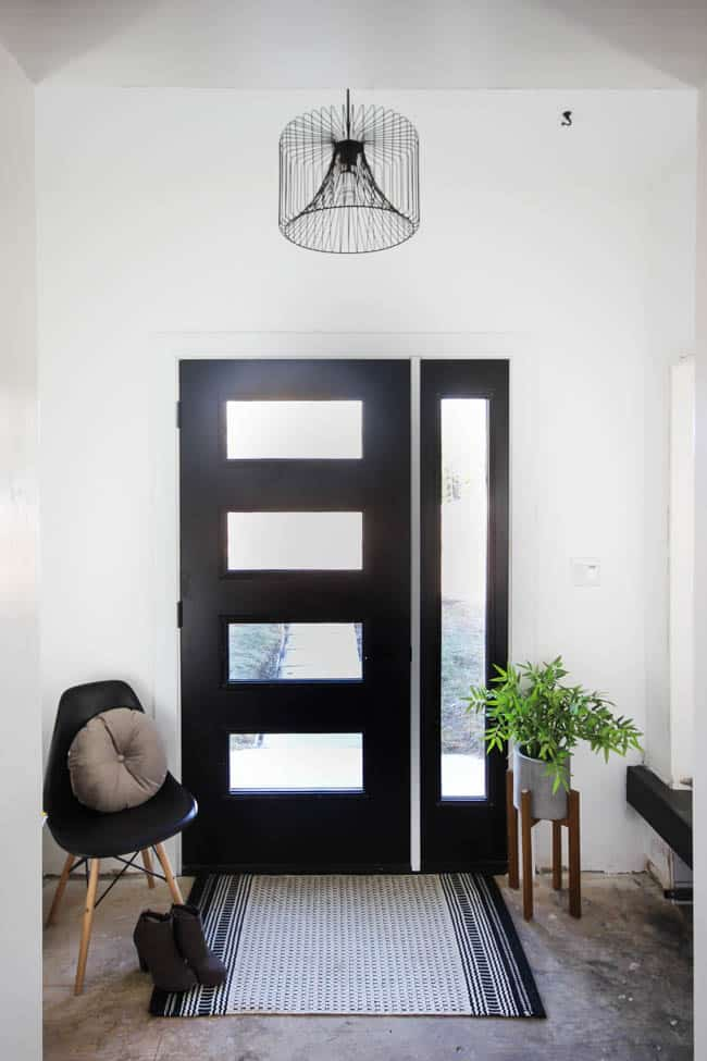 Thinking about replacing your front door? This is everything you need to know before you walk into The Home Depot and pick out a new design! We share how we got the proper measurements and picked our design elements before going to the store. Love the modern design of this new black front door!