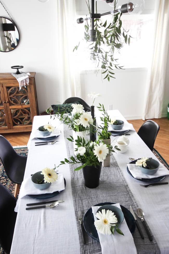 A pretty Mother's Day Tablescape. Love the earthy colours in this black, white, blue and green table setting! Beautiful floral centrepieces and modern place settings will make for the perfect spring event!